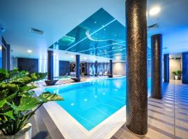 Wellton Riverside SPA Hotel, отель в Риге