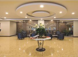 Horison Sky Kualanamu, отель в Медане
