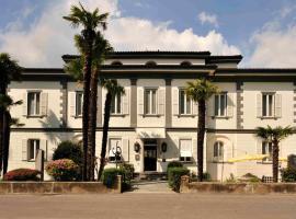 Albergo Gardenia, hotell i Caslano