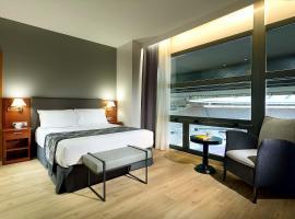 Exe Isla Cartuja, hotel en Sevilla