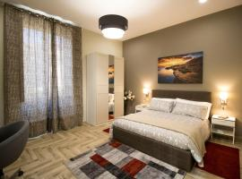 Romeo Luxury Apartment, camera con cucina a Catania