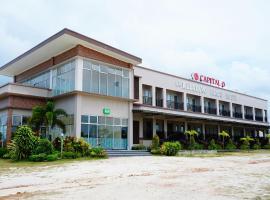 Capital O 399 Kelayang Beach Hotel, hotel di Sijuk