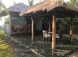 Waterfront Balinese Bungalow - romantic getaway, hotel near Croix d' Ouambo, Naïa