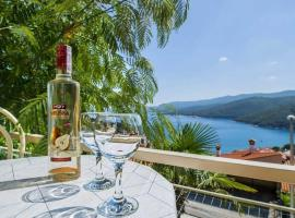 Apartments and rooms Gracia - with great view, B&B in Rabac