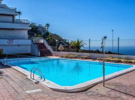 APT with sea view and large swimming pool, hotel in Amadores
