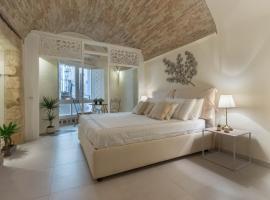 DOMO 5 TESTE, guest house in Cagliari