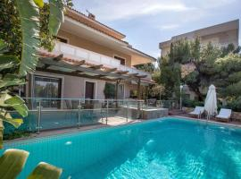 Exceptional Villa in Voula near the sea, hotel with pools in Athens