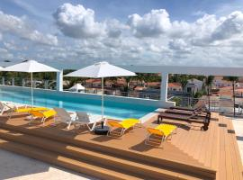 TrueCost Сaribbean Paradise Rooftop Pool, hotel in Punta Cana