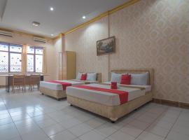 RedDoorz near Hermina Hospital Palembang, family hotel in Palembang