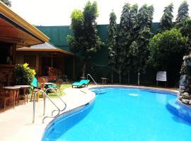 Dolce Vita Hotel, отель в Пуэрто-Принсеса