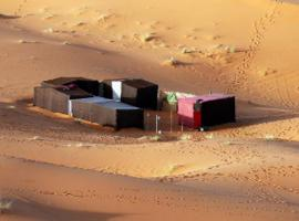 merzouga camp experience, luxury tent in Hassilabied