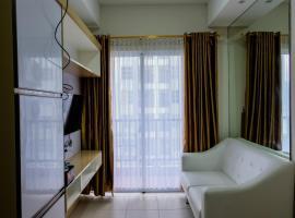 Cozy 1BR Unit Saveria Apartment By Travelio, hotel in Samporo