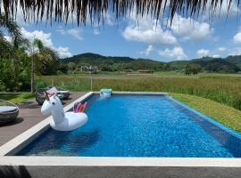 Cloud9 Holiday Cottages, villa in Pantai Cenang