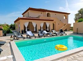 MOLAROTTO CAMERE CON ANGOLO COTTURA, hotel with pools in San Teodoro