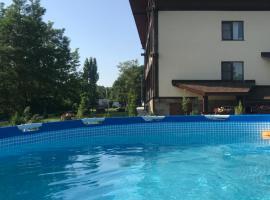 Guest house Podkova, family hotel in Dakhovskaya