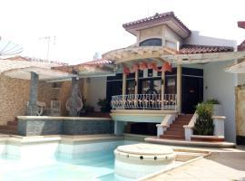 T-Rooms Homestay @Lapangan Hatta, holiday home in Palembang
