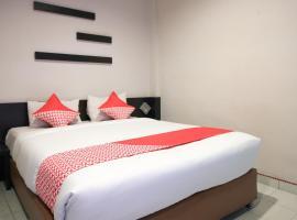 OYO 717 Hotel Dharma Utama Syariah, hotel near Sultan Syarif Kasim II International Airport - PKU, Pekanbaru