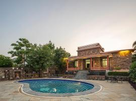 The Wild Orchid By Vista Rooms, hotel with pools in Udaipur