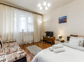 Уютные, семейные апартаменты на Грина 34к1, hotel in Moscow
