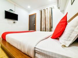 OYO 5727 Coco Homes, hotel en Candolim