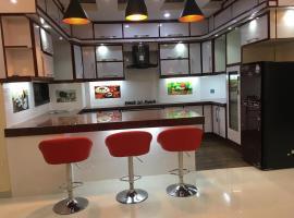 Syed's place, hotel near Jinnah International Airport - KHI,