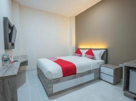 OYO 1487 Residence Khoe Near RS Royal Taruma, hotel in Jakarta