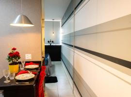 Apartamento com café da manhã no Centro - Conforto e preço baixo, family hotel in Goiânia