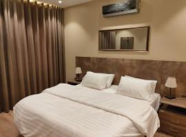 Hamsun Suites ( Nursery Shahra e Faisal ), hotel near Jinnah International Airport - KHI, Karachi