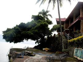 Romlan, guest house in Tuktuk Siadong