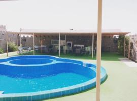 Green guest resort - Alnuzul AlKhdhra Resort النزل الخضراء, homestay in Bilād Manaḩ