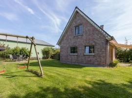 Pleasant family home, located at a 10-minute walk from the North Sea beach, holiday home in Vrouwenpolder