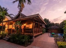 Nature's Abode by Vista Rooms, hotel with pools in Morjim