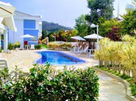 Linda Casa de Condomínio com piscina, casa de temporada em Florianópolis