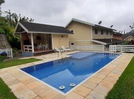 Aconchego em Teresópolis com piscina privativa, holiday home in Teresópolis