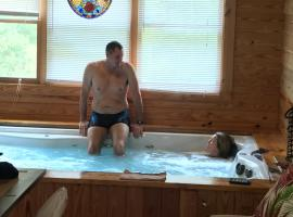 PRIVATE Log Cabin with Indoor pool sauna and gym YOU RENT IT ALL NO ONE ELSE, lodge in McAlpin