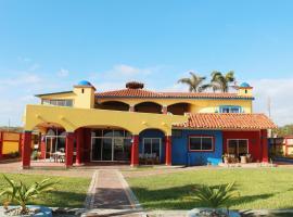 Casa Amarilla, villa in Puerto Cayo