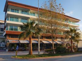 Axoi Apartments, отель в городе Чамйолу, рядом находится Муниципалитет Кестель