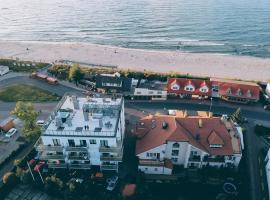 Al Mare - Apartamenty i pokoje, hotel with jacuzzis in Sarbinowo