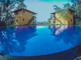 Amri River Cottages And Ayurvedee Retreat, hotel in Bentota