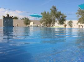 villa la rose des sables, guest house in Midoun