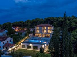 Villa D a luxury villa on Brac, pool and sauna, hotel v destinaci Postira