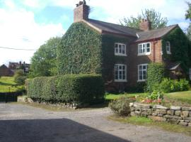Ash Farm Country House, guest house in Little Bollington