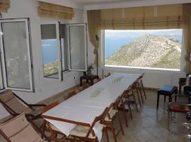 VILLA EVA-MAGNIFICENT SEA VIEW-50Km FROM ATHENS, hotel in Marathon