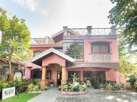 OYO 426 Coco Grove Tourist Inn, hotel in Panglao Island