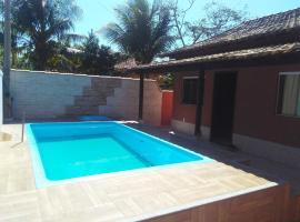 Real Apartments 281 - Casa com 2 quartos e uma linda piscina em Cabo Frio, hotel in Rio de Janeiro