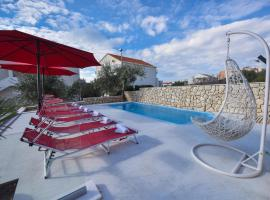Apartments and rooms with a swimming pool Novalja, Pag - 9334, guest house in Novalja