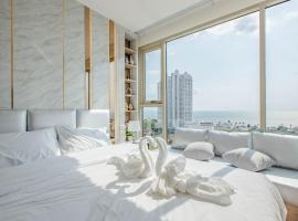 Riviera Jomtien 1 Bed 1 living room Seaview อพาร์ตเมนต์ในหาดจอมเทียน