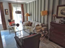 Duplex, terraza, 10 min coche centro Sevilla, hotel en Camas