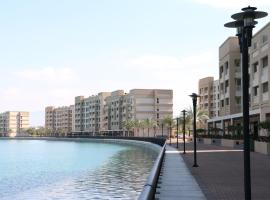 RH - Cozy 1BR Retreat in RAK, Walk to beach, apartment in Ras al Khaimah