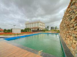 New Milestone Hotel, hotel in Vānivilāsa Puram